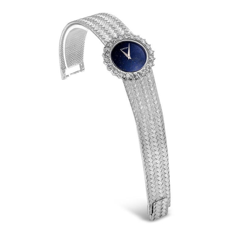 A rare limited edition Piaget for Cartier watch showcasing a lapis lazuli dial and a brilliant diamond bezel. Diamonds are approximately 2.50 carats total weight, F color, VS clarity. Set in a weave design bracelet made in 18 karat white gold.