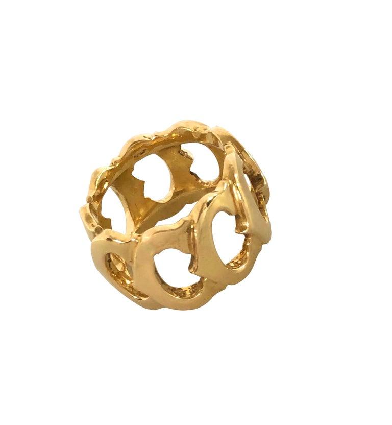 Circa 2000 Cartier C de Cartier 18K yellow Gold band Ring, Continuous connected Cartier