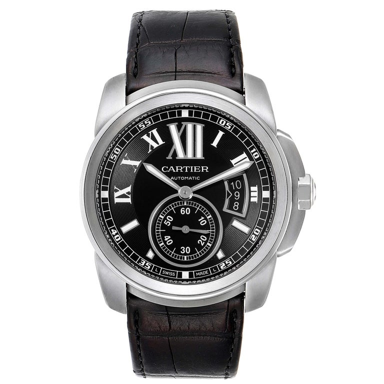 Cartier Calibre Black Dial Automatic Steel Mens Watch W7100041. Automatic self-winding movement. Stainless steel case 42.0 mm in diameter. Crown cover with faceted blue spinel. Exhibition case back. High polished stainless steel bezel. Scratch