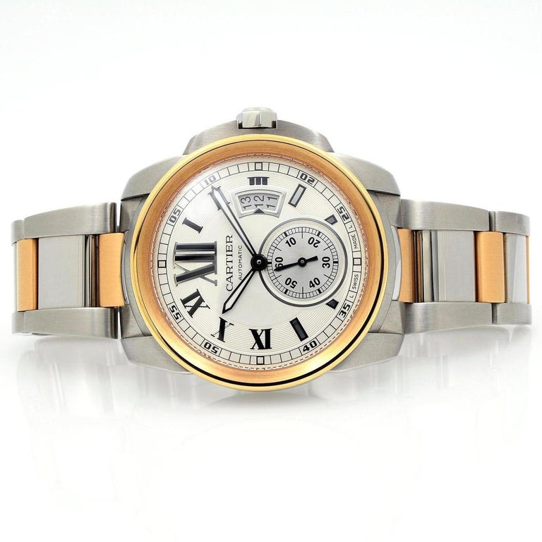 Model: Calibre de Cartier Movement: Automatic Case Material: 18k Pink Gold Case Size: 42mm Dial: Silver Roman Strap: 18k Pink Gold & Stainless Steel Bracelet Includes box and papers