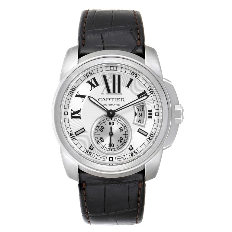 Cartier Calibre Silver Dial Steel Mens Watch W7100037 Box Papers. Automatic self-winding movement. Stainless steel round case 42.0 mm in diameter. Crown cover with faceted blue spinel. Exhibition case back. Stainless steel bezel. Scratch resistant