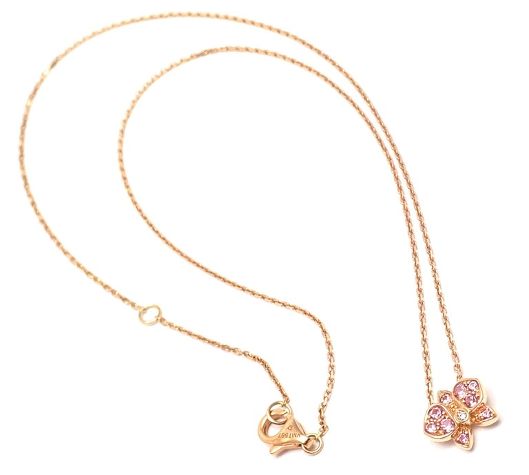 18k Rose Gold Caresse D'orchidées Orchid Flower Pink Sapphire And Diamond Pendant Necklace by Cartier. With 1 round brilliant cut diamond 9 round pink sapphires Details:  Length: 16
