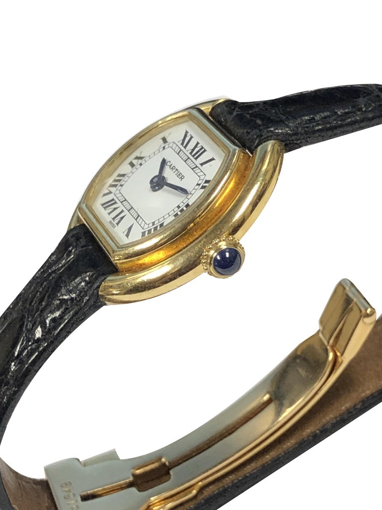 Circa 1970s Cartier Centure collection Wrist Watch, 23 X 26 M.M. 18K Yellow Gold 2 piece stepped case, Sapphire Crown, 17 Jewel Mechanical, manual wind movement.  White Dial with Black Roman numerals. Original Cartier Black Croco Strap with Cartier