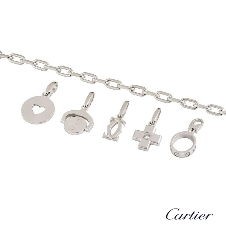 Round Cut Cartier Charm Bracelet with Five Unique Charms Including Love Charm For Sale