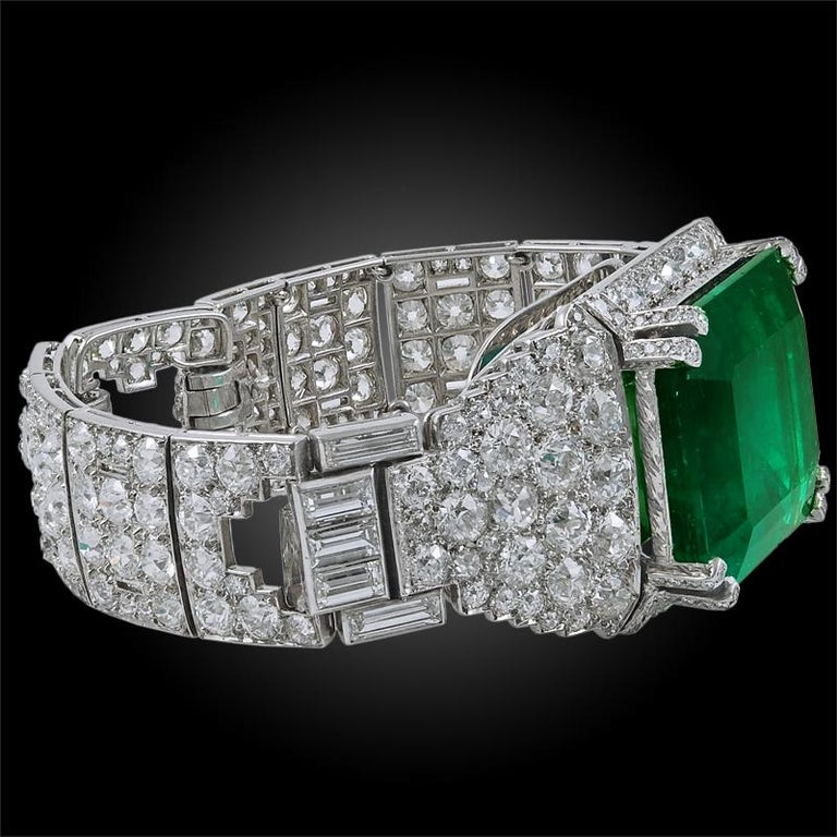 An outstanding Cartier bracelet comprising a phenomenal large rectangular-cut Colombian emerald weighing approx. 58.98 carats surrounded by an opulence of round cut diamonds and an old baguette-cut diamond bracelet, finely crafted in platinum,