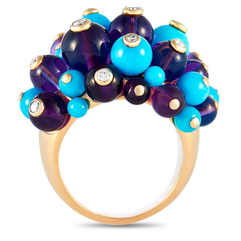 """The Cartier """"Delices"""" ring is made of 18K yellow gold and weighs 35.8 grams. It boasts band thickness of 4 mm and top height of 15 mm, while top dimensions measure 30 by 25 mm. The ring is embellished with turquoises, amethysts, and a total of"""