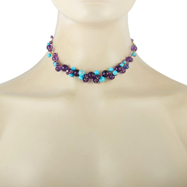 "The Cartier ""Delices"" necklace is made of 18K yellow gold and weighs 34 grams, measuring 15"" in length. It is embellished with turquoises, amethysts, and a total of 0.70 carats of diamonds that boast E color and VS1 clarity.  This jewelry piece is"
