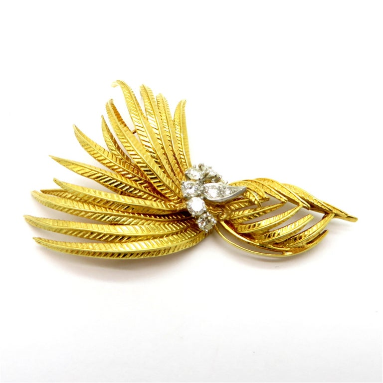 Estate Cartier designer round 1 carat diamond feather 18K two-tone brooch pin #1393. Interspersed with eight round brilliant cut diamonds, prong and bead set, weighing a combined total of approximately 1.00 carat. The reverse side features a curved