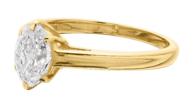 Modern Cartier Diamond, Oval Shape Engagement Ring set in British Hallmarked 18K Gold For Sale