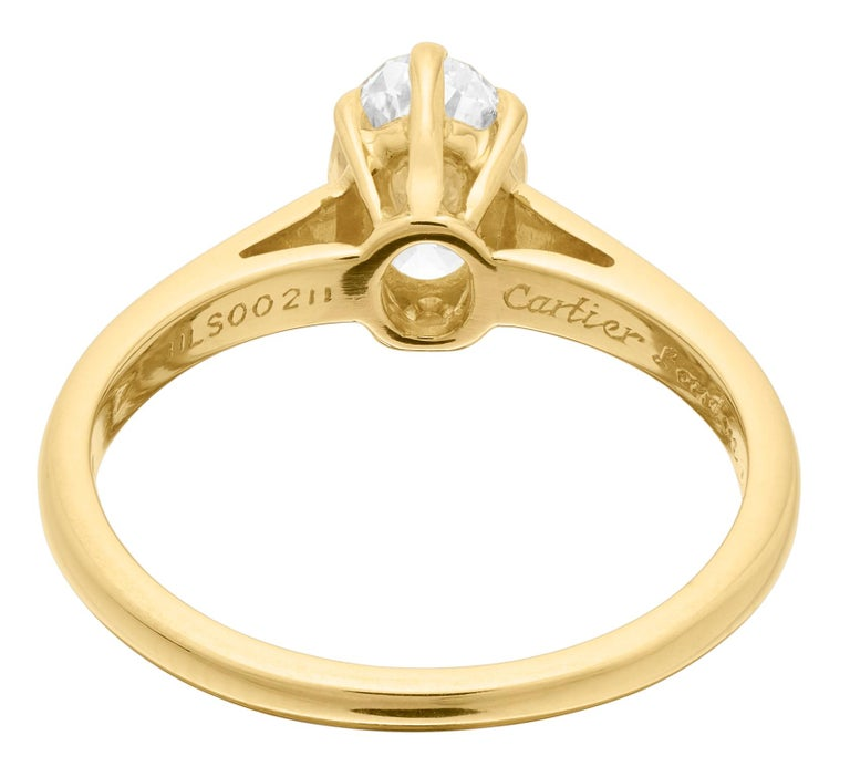Oval Cut Cartier Diamond, Oval Shape Engagement Ring set in British Hallmarked 18K Gold For Sale