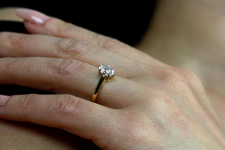 Women's Cartier Diamond, Oval Shape Engagement Ring set in British Hallmarked 18K Gold For Sale