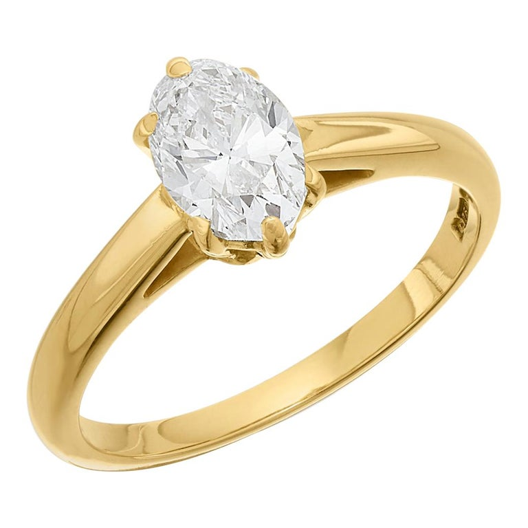 Cartier Diamond, Oval Shape Engagement Ring set in British Hallmarked 18K Gold For Sale