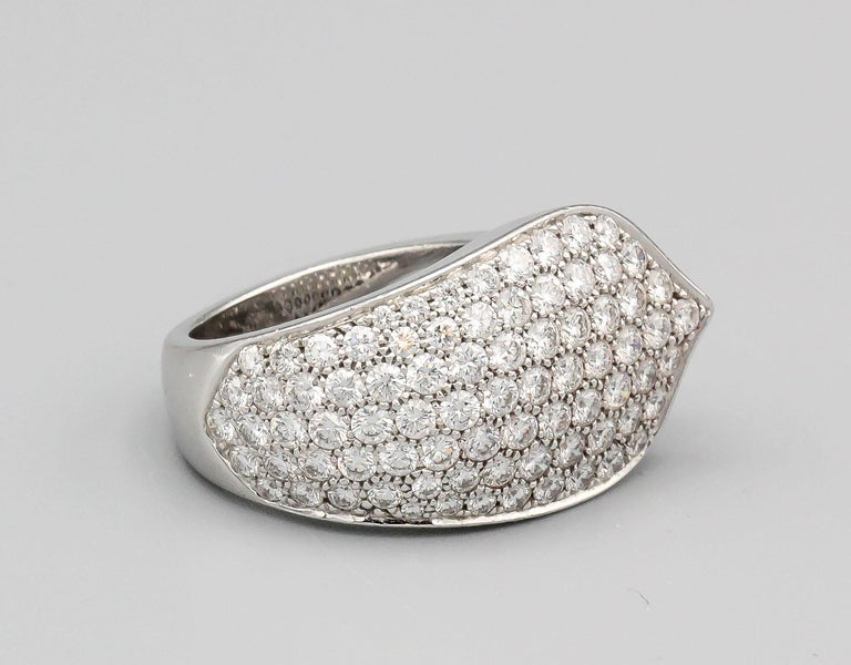 Elegant diamond and 18K white gold ring by Cartier. It features high grade round brilliant cut diamonds, approx. 5cts total weight.  Euro size 55, US size 7.  Hallmarks: cartier, 750, copyright, reference numbers, French 18K gold assay mark, maker's