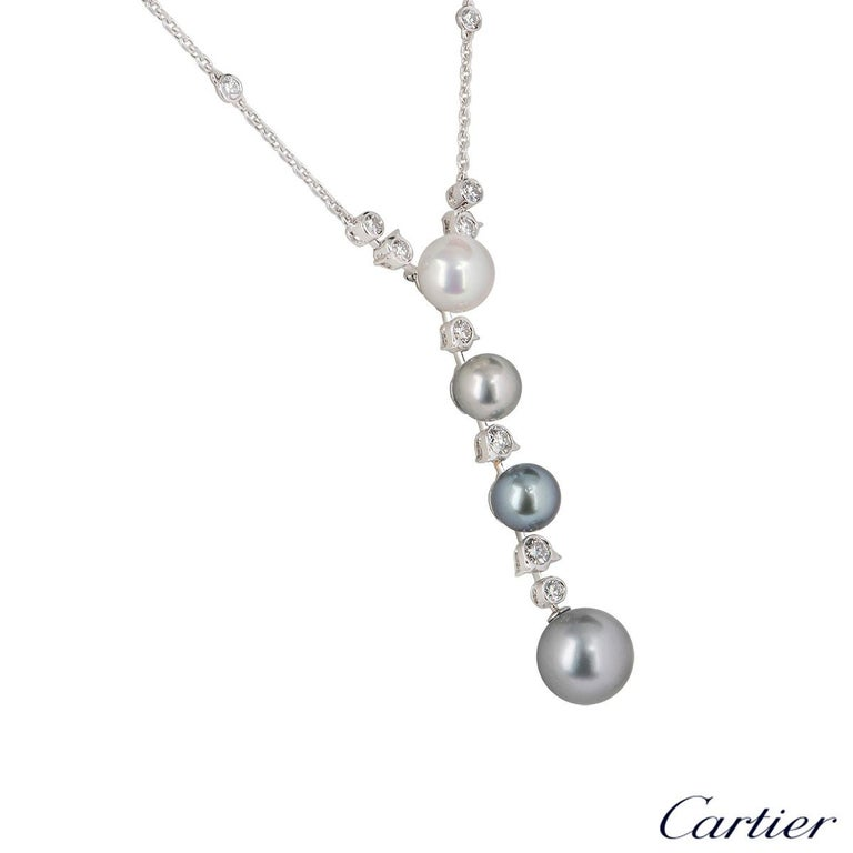 A stunning white gold pearl and diamond necklace by Cartier from the Calin collection. The necklace comprises of 4 pearls Tahitian and cultured suspended at the bottom alternating in sizes with 16 round brilliant cut diamonds also in alternating
