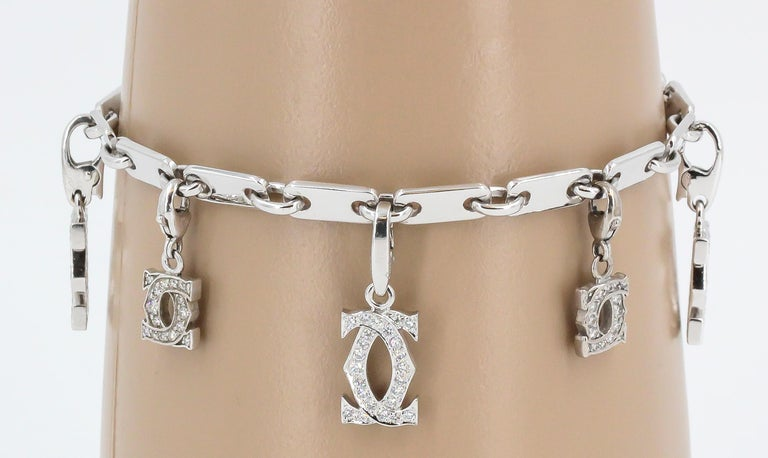 CARTIER Diamond and White Gold Charm Bracelet For Sale 1