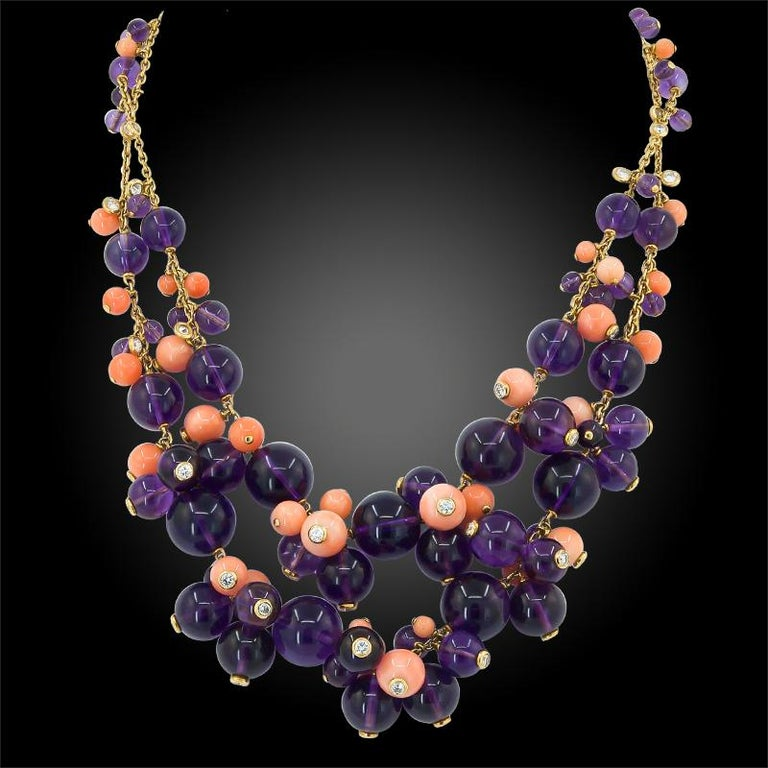 Comprising a 'Delice de Goa'  suite by Cartier, featuring a ring, necklace and earrings of similar design, each set with finely crafted clusters of polished coral and amethyst beads, some beads accentuated with bezel-set brilliant diamonds at the