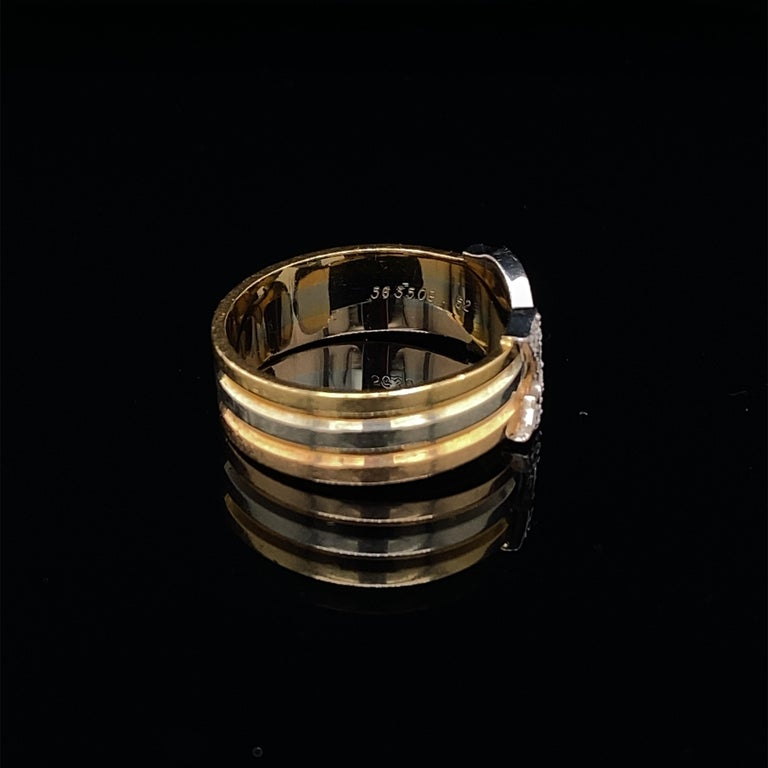 A fabulous diamond set double-C band ring by Cartier crafted in 18 karat yellow white and rose gold.  Such an incredibly wearable recognizable statement ring with the two C's pave set with round brilliant cut diamonds of 0.20 carats