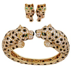 Cartier Diamond, Emerald Onyx Two Head Panther Bangle and Earclips