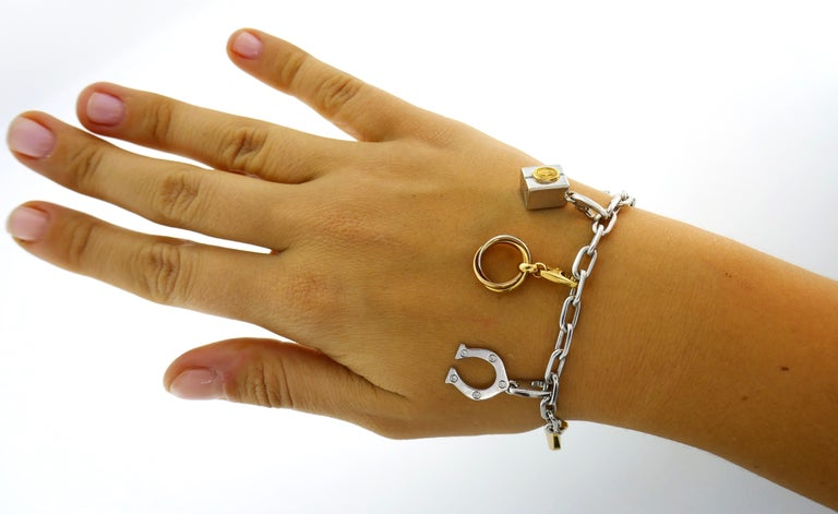 Fabulous charm bracelet created by Cartier in France in 1990. Chic, fun and wearable, the bracelet is a great addition to your jewelry collection. The bracelet and the charms are made of 18 karat gold, the horseshoe charm is set with five round