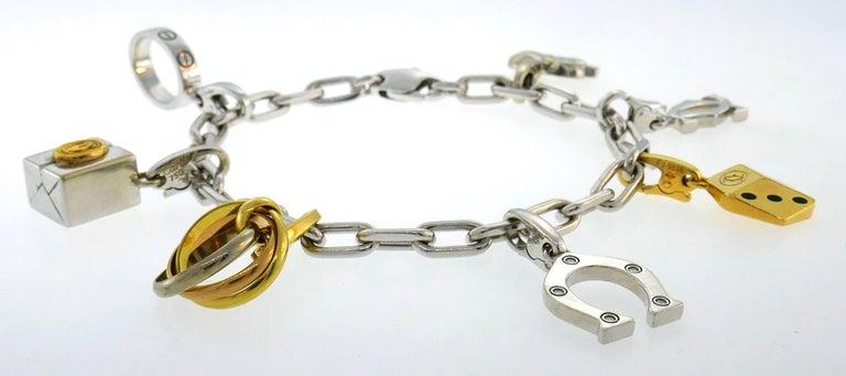 Women's Cartier Diamond Gold Charm Bracelet with Signature Cartier Charms