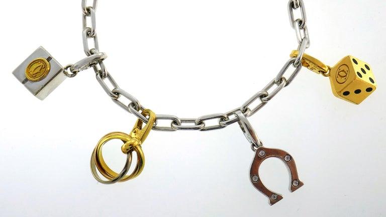 Cartier Diamond Gold Charm Bracelet with Signature Cartier Charms 1