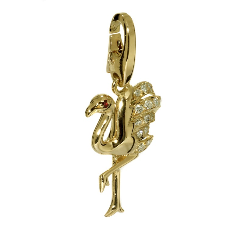 An extremely rare Cartier Flamingo pendant/ charm charm set with the finest Cartier round brilliant cut diamonds in 18k yellow gold.  Dimensions: 15mm wide (.59″ Inches) by 31mm (1.22″ Inches) in length  Inventory ID: 0000148