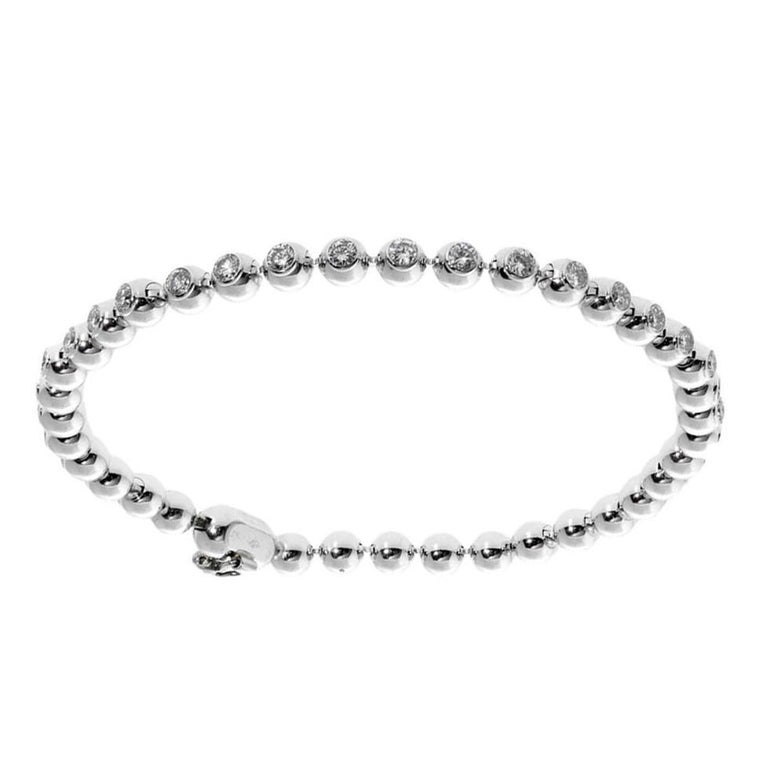 A chic authentic Cartier beaded tennis bracelet in 18k white gold featuring 2.04cts of the finest Vs quality round brilliant cut diamonds.   Length: 6 1/2″