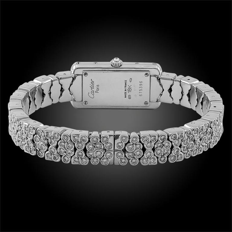An elegant french Cartier ladies watch from the 1990s, thoroughly embellished with brilliant diamonds, crafted with a rectangular dial, set in 18k white gold.