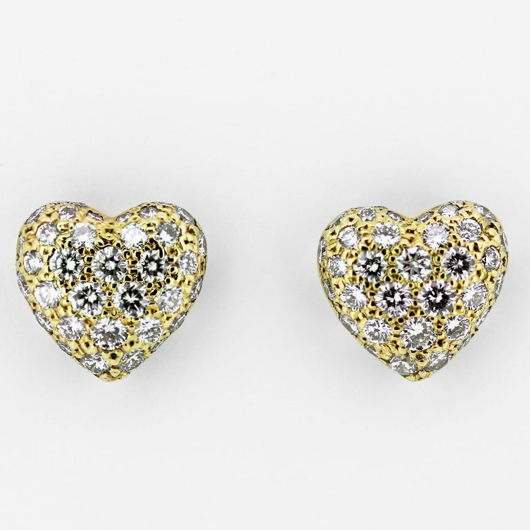 Heart shape a pair of earrings and ring with diamonds by Cartier and perfect for valentines present. Set with round brilliant diamonds approximate total weight 1.80 to 2.0 carats. Assessed colour G/H. Assessed Clarity VS Gross weight for earrings