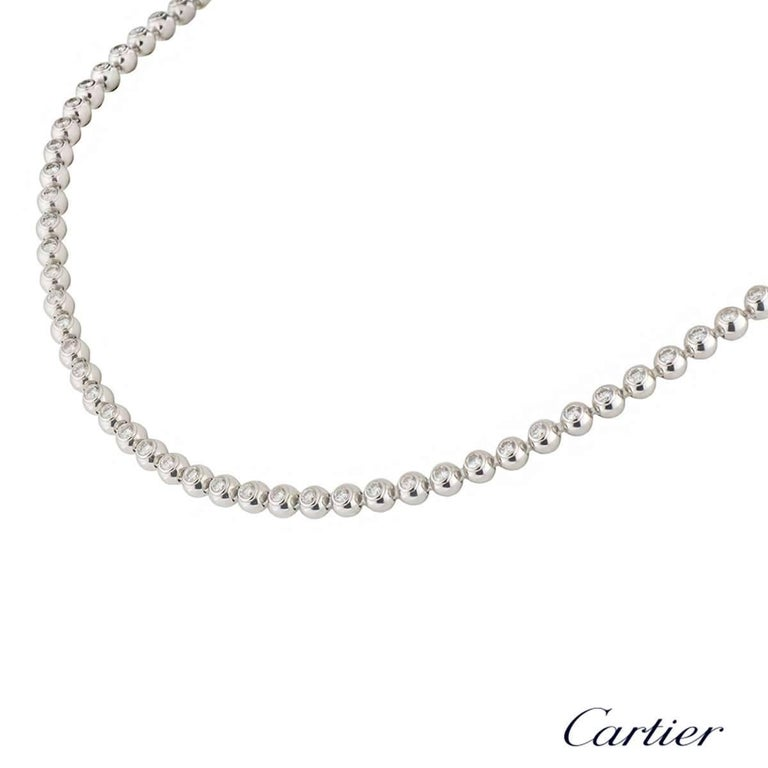 A beautiful 18k white gold Cartier diamond necklace from the Moonlight collection. The necklace comprises of 84 ball motifs with a round brilliant cut diamond in each ball in a rubover setting. The diamonds have a total weight of approximately