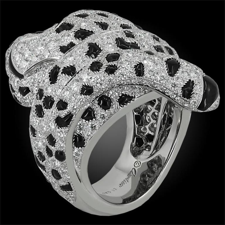 CARTIER Panthere Diamond Onyx Coil Ring in Platinum.  An extraordinary adornment embodying the Maison's most iconic creature, the Panthère de Cartier coiled ring features white diamonds set in the French pave style, with accents of dark cabochon-cut