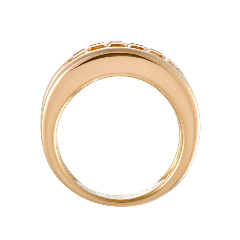 This exquisite 18K yellow gold ring by Cartier features a chic and elegant style. Its gorgeous design is adorned in a sparkling pave of 1.20ct yellow sapphires surrounded by 0.50ct of dazzling diamonds that add glamour to the stunning ring. Ring