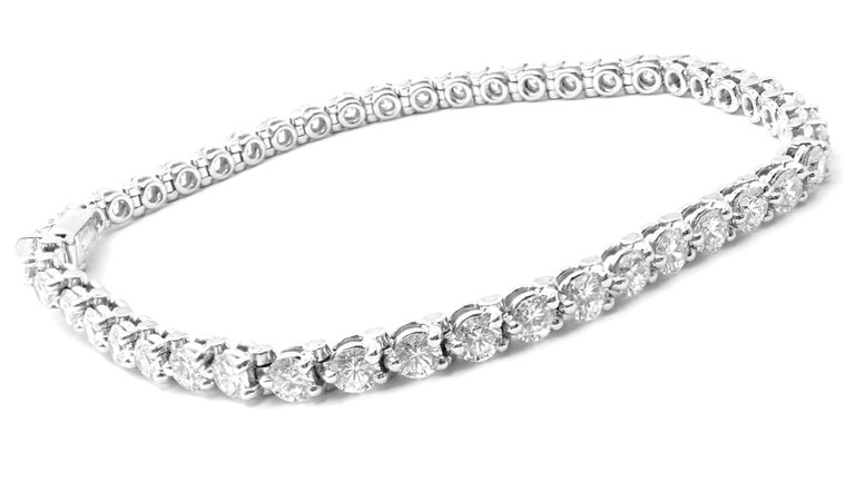 Platinum Diamond Line Tennis Bracelet by Cartier.  This bracelet comes with Cartier box. With 46 Round brilliant cut diamonds  VVS1 clarity, E color total weight approx. 4.14ct Details:  Length: 6.5