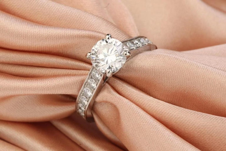 This stunning pre-owned Cartier Solitaire ring has been beautifully crafted from platinum, set with a dazzling brilliant cut 1.23-carat diamond, which has been GIA certificated (2317785223) The beautiful convex shoulders are paved with brilliant-cut