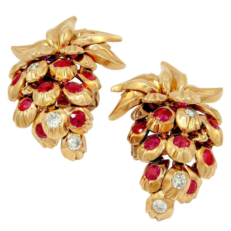 """CARTIER Diamond, Ruby Strawberry Motif Earrings A pair of 18k rose gold strawberry motif ear clips, set with diamonds and ruby. measures approx. -1.50″ in length by  1″ in width Signed """"CARTIER PARIS"""", circa 1950s Condition: Good - Previously owned"""