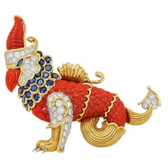 Cartier Diamond Sapphire Carved Coral Gold Griffin Brooch