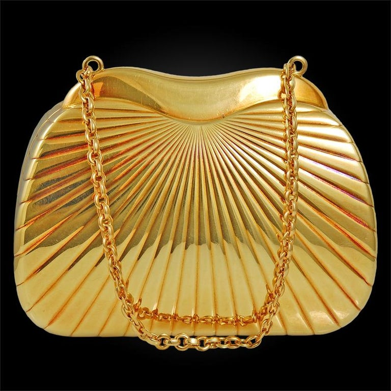 18k yellow gold diamond and cabochon sapphire evening purse signed Cartier. approx. 196.6 dwt. circa 1980