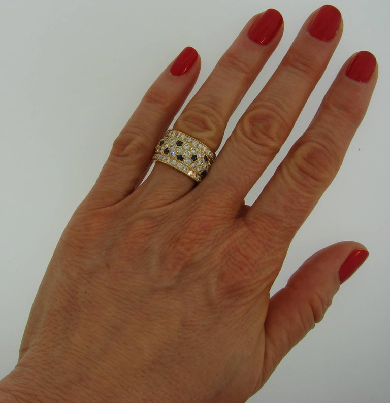 Bold yet elegant ring created by Cartier in France. Classy and timeless design, perfect proportions, finest gems are the highlights of this beautiful ring. Chic and wearable, the band is a great addition to your jewelry collection. The ring is made