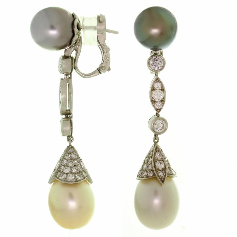 These spectacular Cartier drop earrings are crafted in 950 platinum and set with brillinant-cut round D-F VVS1-VVS2 diamonds weighing an estimated 2.50 carats, round Tahitian pearls measuring an estimated 10.5mm and pear-shaped south sea pearls