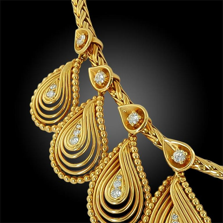 18k yellow gold set with diamond, teardrop motif necklace, signed Cartier. Circa 1960s