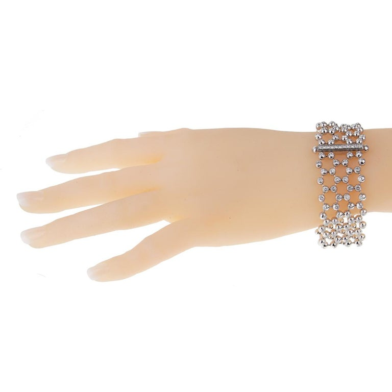 This Cartier diamond gold tennis bracelet is a perfect example of craftsmanship meeting flawless design. 8.2 carats of the finest Cartier round brilliant cut diamonds are embedded throughout this Cartier multi strand diamond gold tennis bracelet,