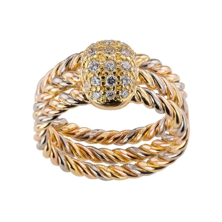Cartier diamond and tricolor gold ring circa 1990.  Clear and concise information you want to know is listed below.  Contact us right away if you have additional questions.  We are here to connect you with beautiful and affordable jewelry, and it is