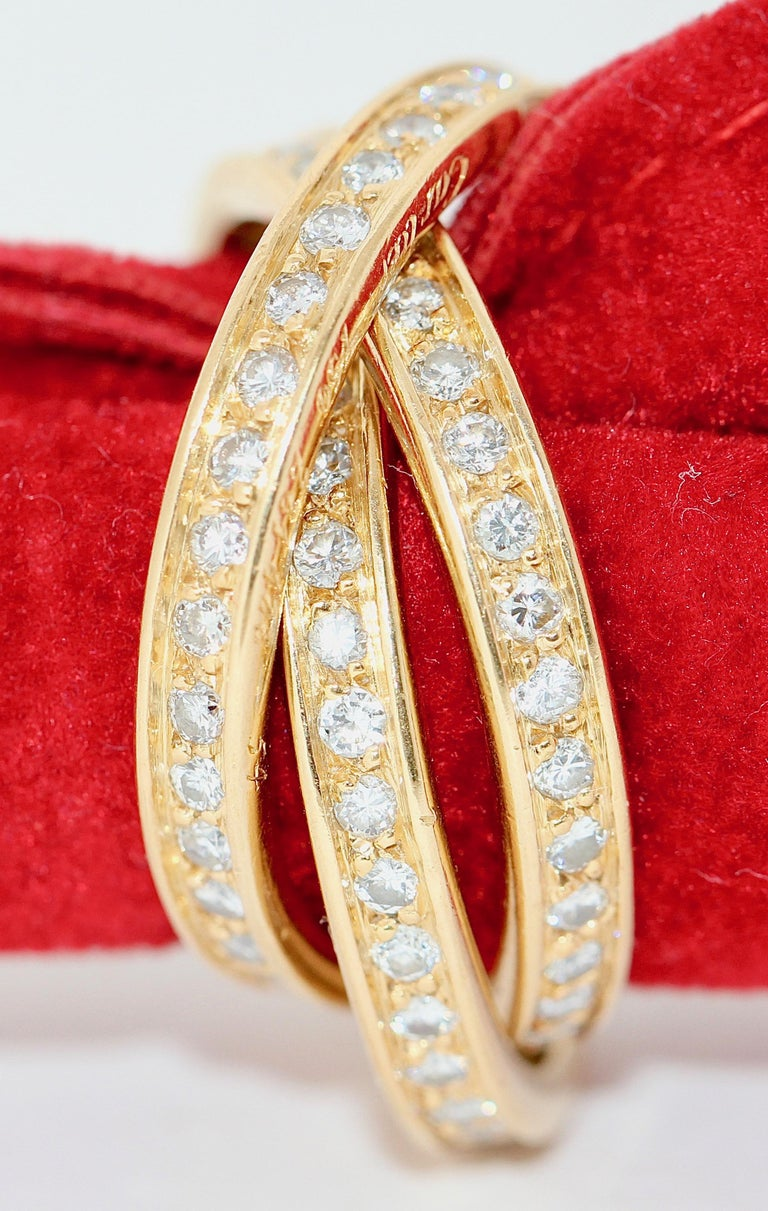 Cartier Diamond Trinity Ring, 18 Karat Gold In Excellent Condition For Sale In Berlin, DE
