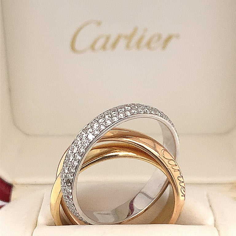 18 white and yellow gold trinity band, RBC diamonds weighing approx. 1.70 cts GH VS, engraved Cartier 750 54 CRD 351395 ring size 6, weight 8.4 dwt. with original box.