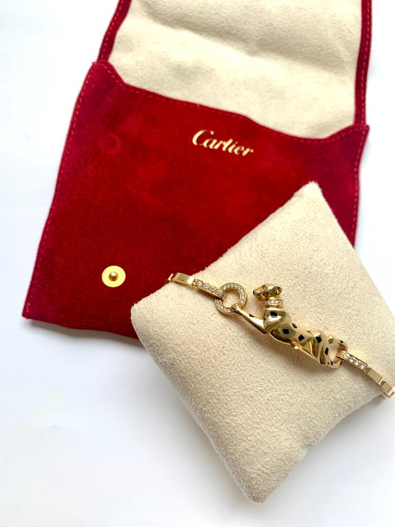 CARTIER Diamond Tsavorite Onyx Panther Bracelet in 18k Yellow Gold. The most iconic creature of the Cartier Maison, the Panthere, first made its debut in 1914. Since then it has become a signature of the brand. This necklace is no exception,