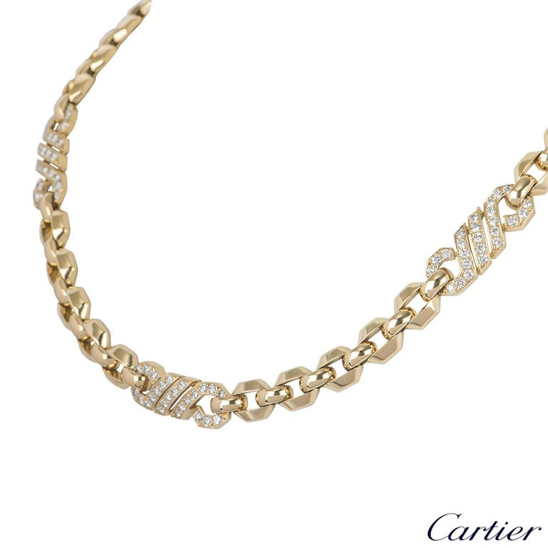 A beautiful 18k yellow gold and diamond necklace by Cartier. The necklace features octagonal links connected by 3 diamond plaques which are set with 75 round brilliant cut diamonds with an approximate weight of 3.00ct. The necklace has a box clasp