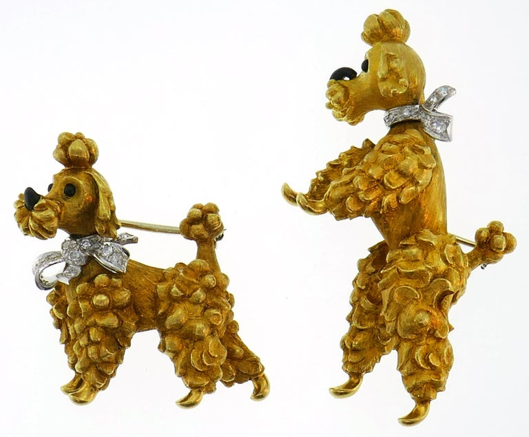 A pair of iconic poodle pins created by Cartier in Italy in the 1950s. Definitely a conversational piece, cute and joyful, the pair is a great addition to your jewelry collection.  The pins are made of 18 karat (stamped) yellow gold, the poodles'