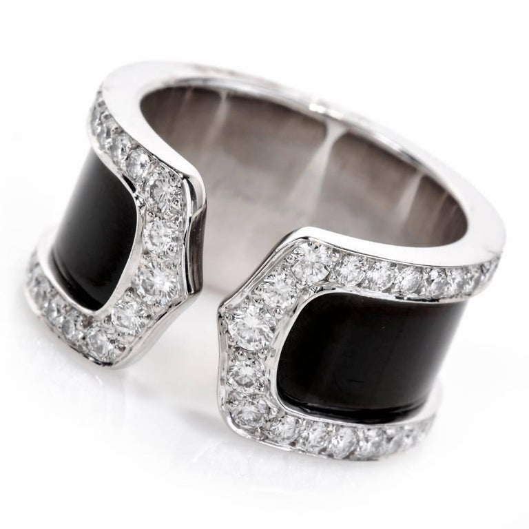 """This dazzling Cartier Diamond  open band """"Double C"""" crafted in solid 18K white gold.It displays a double C open design with its band embellished with black finish enclosed within a frame of 76 genuine round cut Diamonds approx: 0.90cttw, E-F color,"""