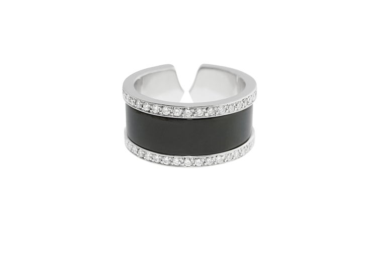 Double C diamond and enamel ring signed by Cartier and numbered K67627. French assay marks mounted in 18K gold with a total estimated weight of 0.9 carats, G-H color, VS clarity. 10mm wide size 7 1/2.