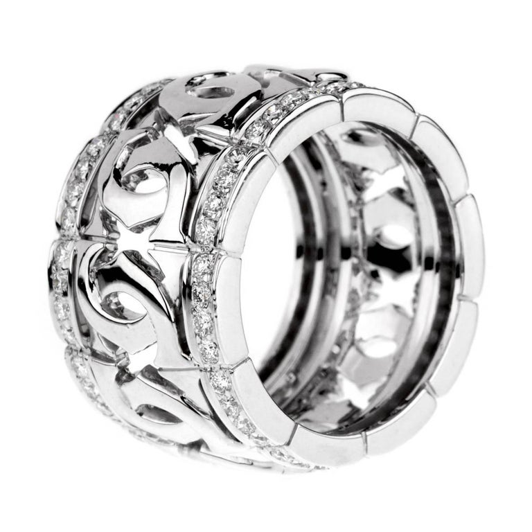 A fabulous iconic Cartier ring featuring the double c motif enhanced by 80 of the finest Cartier round brilliant cut diamonds in 18k white gold. Size 52 / US 6